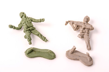 Broken Plastic Toy Soldiers on white background