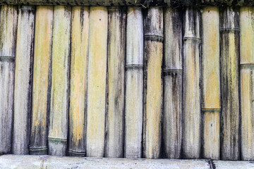 Dry bamboo fence patterned background with vertical bamboo stick