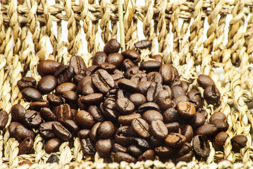 Coffee, fresh aromatic coffee beans in a wicker basket