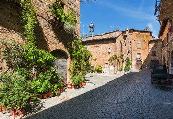 Long shadows on the streets of Italian cities in sunny Tuscany.