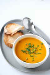 Bowl of Butternut Squash Soup with Bread Slices