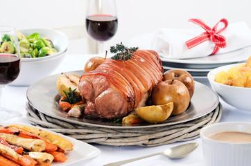 Pork roast dinner with vegetable, potato sides and wine