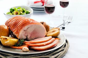 Traditional christmas table setting with pork roast