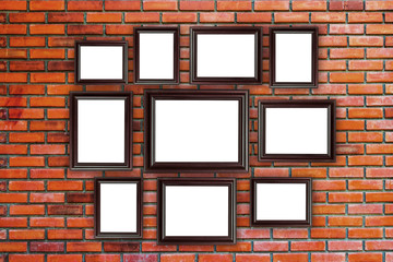 wood frames photo on red brick wall