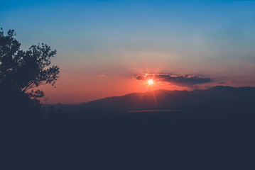 Sunset with mountains and trees