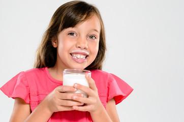 Adorable child with milk moustache
