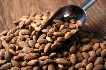 Wall Mural - handful of almonds and scoop