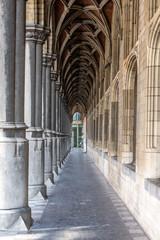 Walking through an archway in Mechelen Belgium