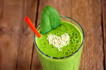 Green smoothie with heart of sesame seeds