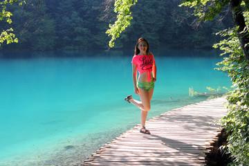 Attractive trekker enjoying summer on the lake