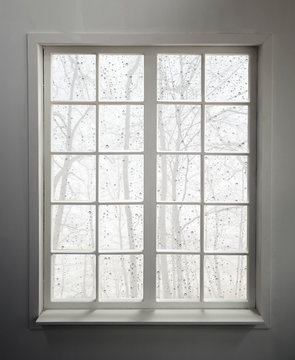 Modern residential window with rain and foggy forest view