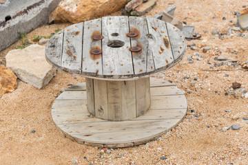 Big old wooden roll on rock coastal beach