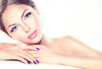 Pure beauty girl . Beautiful model with lilac makeup and manicure.
