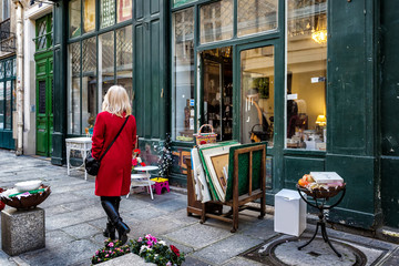 Paris street antique shop sidewalk shopper in red coat