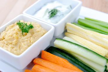Foto op Aluminium Voorgerecht Variety of healthy dips with vegetable sticks
