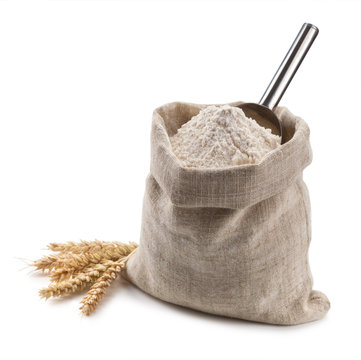 flour in a bag and spikelets isolated on white background