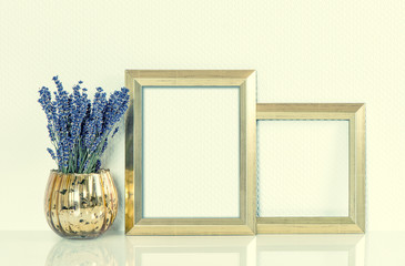 Golden picture frame and lavender flowers. Vintage style toned