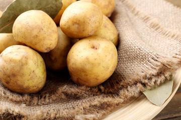 Young potatoes on sackcloth close up