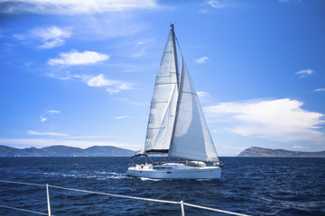 Sailing. Ship yachts with white sails in the Sea. Luxury boats..