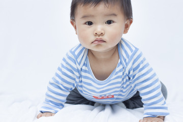 Cute 8 months Chinese boy baby in sailor suit
