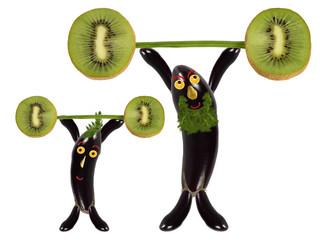 Creative food concept. Two funny eggplant raise the bar of kiwi