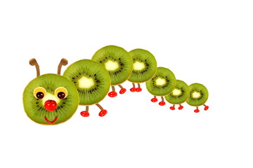 Creative food concept. Funny little  caterpillar made from fruit