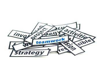 image concept cloud, blue word teamwork on random paper pieces with black frame isolated white