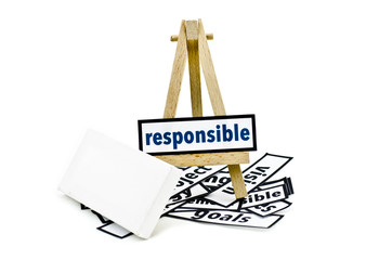 concept responsible word on wooden stand.random cutted print paper and empty canvas frame isolated white background