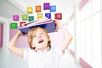 Composite image of cute pupil holding books
