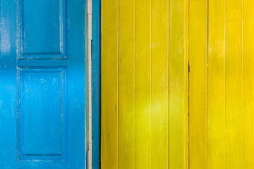 Colorful wooden door and window frames background