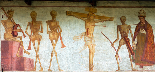 Fresco Macabre Dance - Pinzolo Trento Italy / Detail of fresco La danza macabra (Macabre dance), Simone Baschenis 1539. Ancient church of San Vigilio (1515) in Pinzolo, Trento Italy
