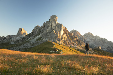 Man photographing the sunrise in Dolomite Mountains