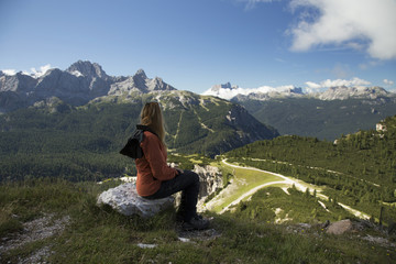 Woman hiker admiring the panorama in Dolomite Mountains