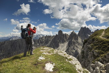 Man photographing in Dolomite Mountains
