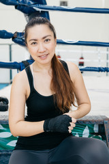 Asian woman hand wrapping in the gym