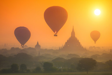 Sunrise over the Old Bagan. Hot air balloons over the ancient pagodas.