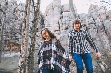couple in love, walk on the rocks Dovbush Carpathian Mountains