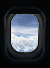Window Airplane with cloudy sky