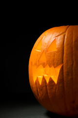 Pumpkin: Spooky Jack-O-Lantern On Black Background
