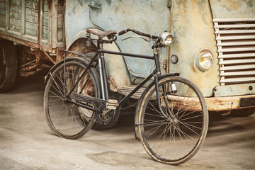 Spoed Foto op Canvas Fiets Retro styled image of an ancient bike and truck