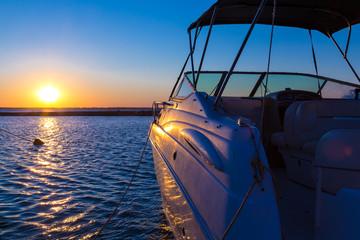 Yacht near the pier against sunset