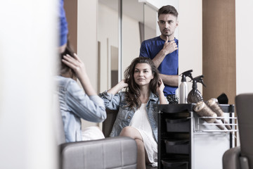 Young woman in hairdressing salon