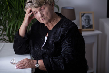 Female retiree being in mourning