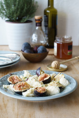 Starter of italian mozzarella cheese and fresh figs. Selective focus