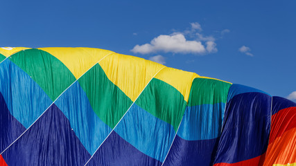 Colorful air balloon against the blue sky