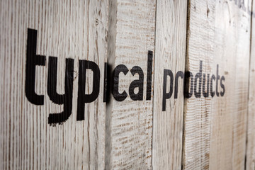 wood wall with text - Typical products and beer