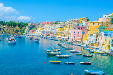 Foto op Aluminium Napels italian island procida is famous for its colorful marina, tiny narrow streets and many beaches which all together attract every year crowds of tourists coming from naples - napoli.