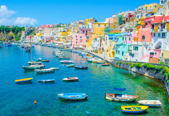 Poster Naples italian island procida is famous for its colorful marina, tiny narrow streets and many beaches which all together attract every year crowds of tourists coming from naples - napoli.
