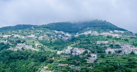 view of steep hills of amalfi coast in italy in area near ravello city and atrani village.