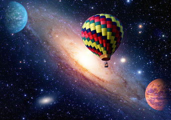 Hot air balloon surreal wonderland fairy tale landscape fantasy planets. Elements of this image furnished by NASA.